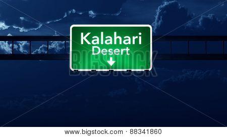 Desert Highway Road Sign At Night