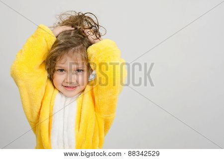 Cheerful Girl In Yellow Bathrobe Holding Hair