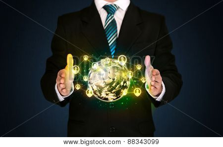 Businessman holding a shining globe with social media connection