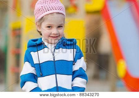 Portrait Of Cheerful Four-year Girl In Playground