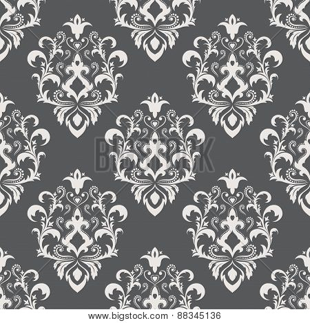 Seamless Texture wallpapers in the style of Baroque . Background of gray and white color .