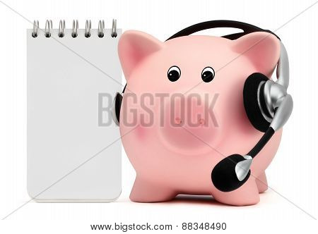 Piggy Bank With Headset And White Block Notes
