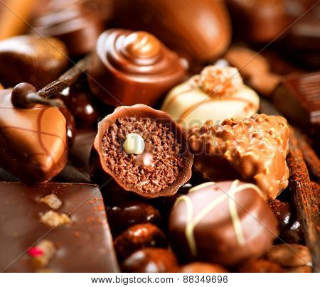 Chocolates background. Chocolate. Assortment of fine chocolates in white, dark, and milk chocolate. Praline Chocolate sweets