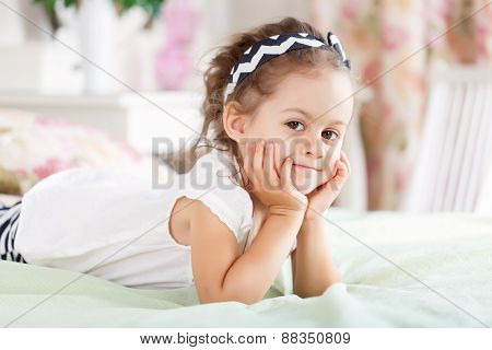 Girl is lying on the bed