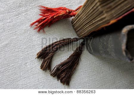 Old books on canvas, focus on tassels