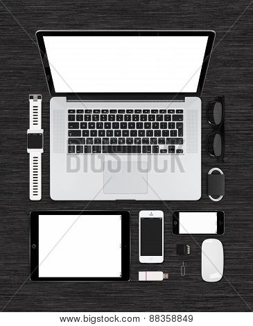 Top View Of Tech Mock Up Consisting Laptop, Tablet Pc, Smartphone, Smartwatch