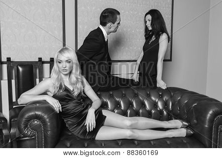A guy and two girls in the room, tense