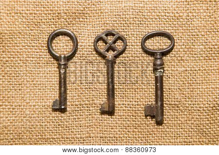 Three  Old Keys To The Safe On A Very Old Cloth