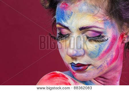 The creative, bright, color makeup. Piercing look. Floral makeup. Beautifully painted lips and eyes
