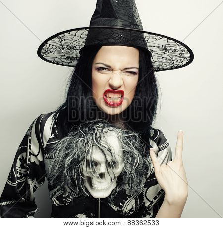 Funny Witch with skull. Holiday picture.