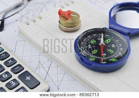 Compass Coin Notebook Calculator And Glasses On Business Graph