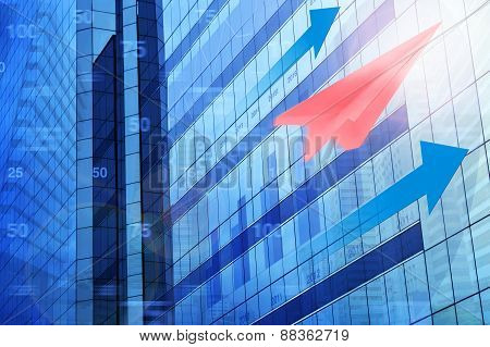 Red Plane Paper With Arrow Head And Financial Chart On Tower City