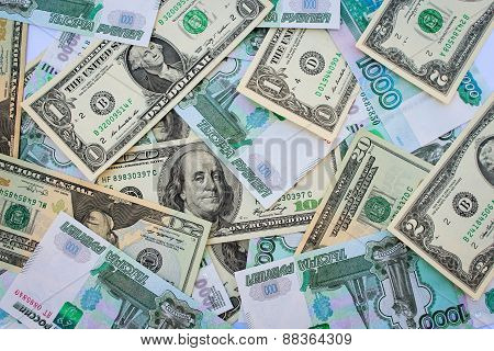 Background different banknotes of us dollars and Russian rubles
