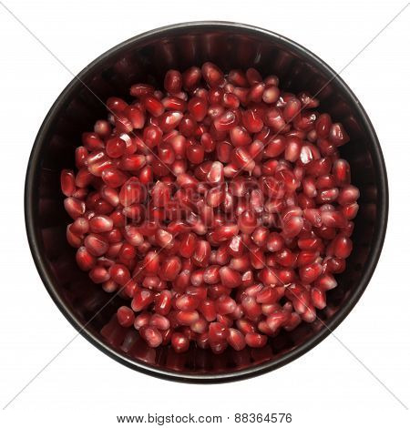 Pomegranate Grains In A Plate Isolated