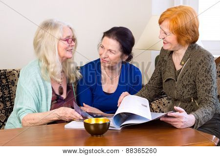 Middle Age Women Friends Talking At Living Area