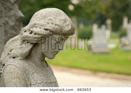 Granite Statue Of Angelic Woman At A Gravesite