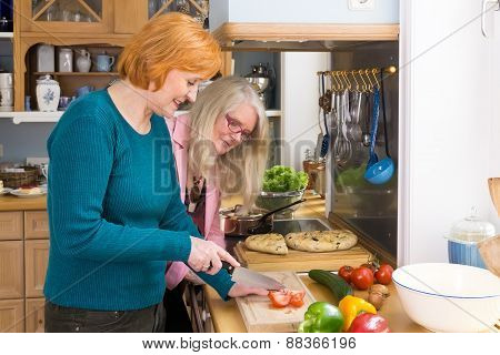 Smiling Mom Showing Her Recipe To Her Friends