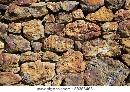 Old stone wall constructed from old copper mine stone