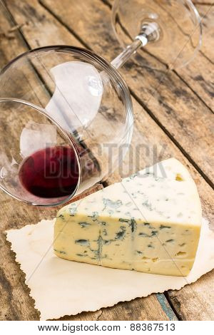 Blue Cheese On Vintage Paper With Overturned Wineglass