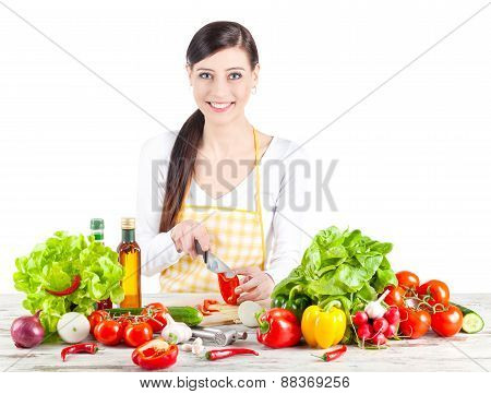 Smiling Woman Preparing Salad.