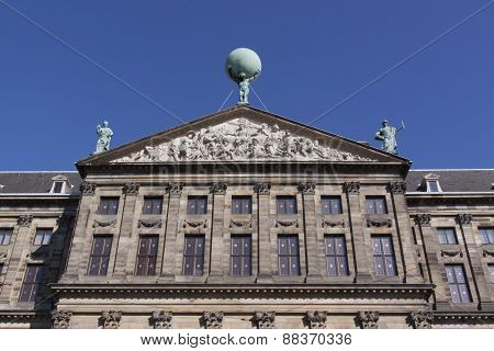 Statue Of Atlas On The Royal Palace In Amsterdam