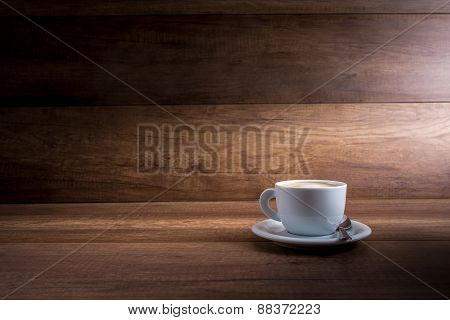 Cup Of Cappuccino On A Wood Background