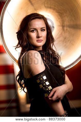 Closeup Portrait Of Sexy Brunette Woman Posing Against Beauty Dish