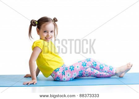 child doing gymnastics exercises