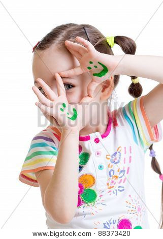 Funny child girl showing painted hands with smiling face