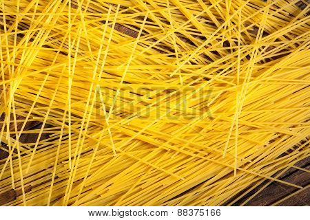 italian spaghetti on wooden background. Top view