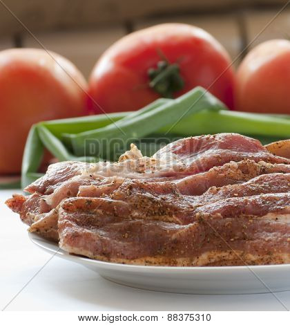 Fresh raw pork with fresh, vegetables.