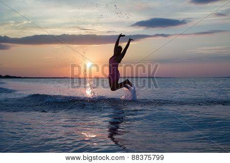 girl having fun on the sea beach