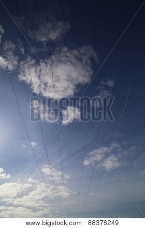 Cables Of High Voltage Line On Dark Blue Sky