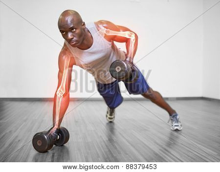 Digital composite of Highlighted arm of strong man lifting weights