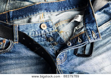 Detail Of Nice Blue Jeans With Leather Belt