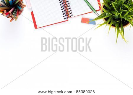 Office desk table with supplies and flower. Isolated on white background. Top view with copy space