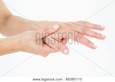 Woman suffering from hand pain on white background