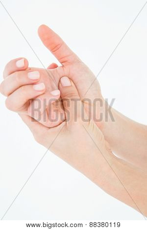 Woman with hand pain on white background