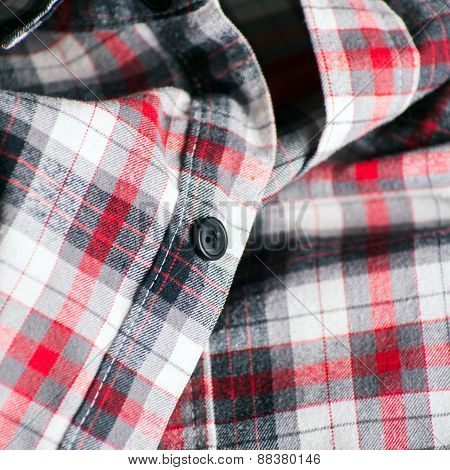 Close Up Detail Of A Red Plaid Button Style Shirt
