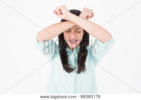 Troubled woman crying on white background