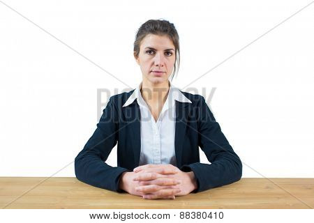 Businesswoman frowning at the camera shot in studio