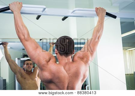 Man at the gym. Man makes exercises