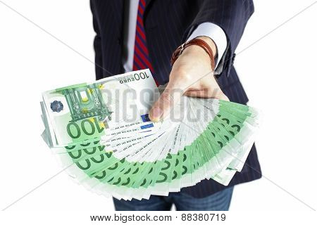 Businessman holding many euros