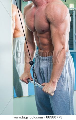 Man with weight training equipment on sport gym club.Man makes exercises.