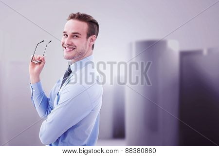 Businessman smiling against abstract white room