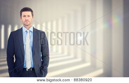 Businessman looking at the camera against curved white room