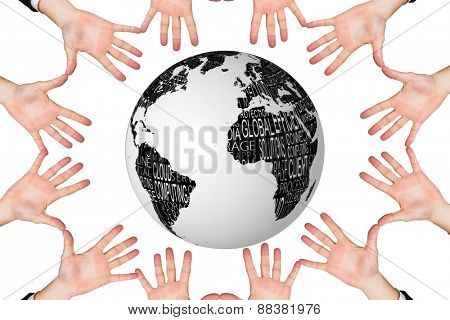 Circle of hands against black and white earth