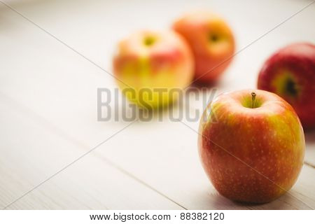 Fresh red apples on wooden background