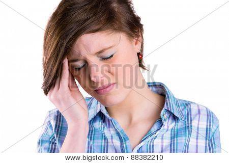 Pretty brunette getting a headache on white background