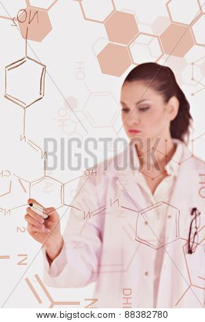 Science and medical graphic against darkhaired scientist writing a formula on a white board